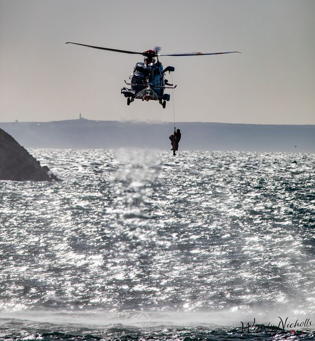 One of the six people getting airlifted from rocks at Putsborough in North Devon