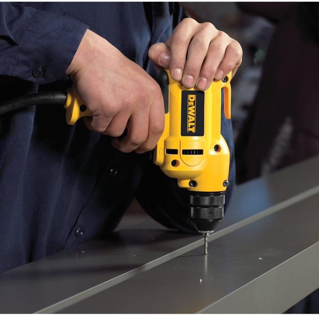 person using DEWALT Corded Drill
