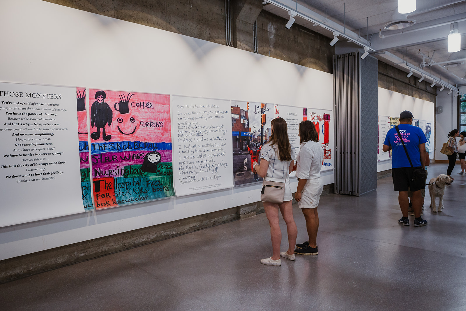 Two visitors stand in front of Teresa's 'Those Monsters' artwork at the opening of Born To Represent on July 22, 2019. Photo: This Is It Studios.