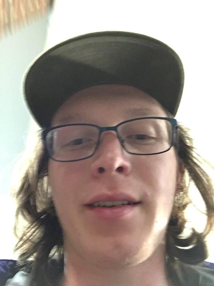 Image may contain: 1 person, smiling, eyeglasses and closeup
