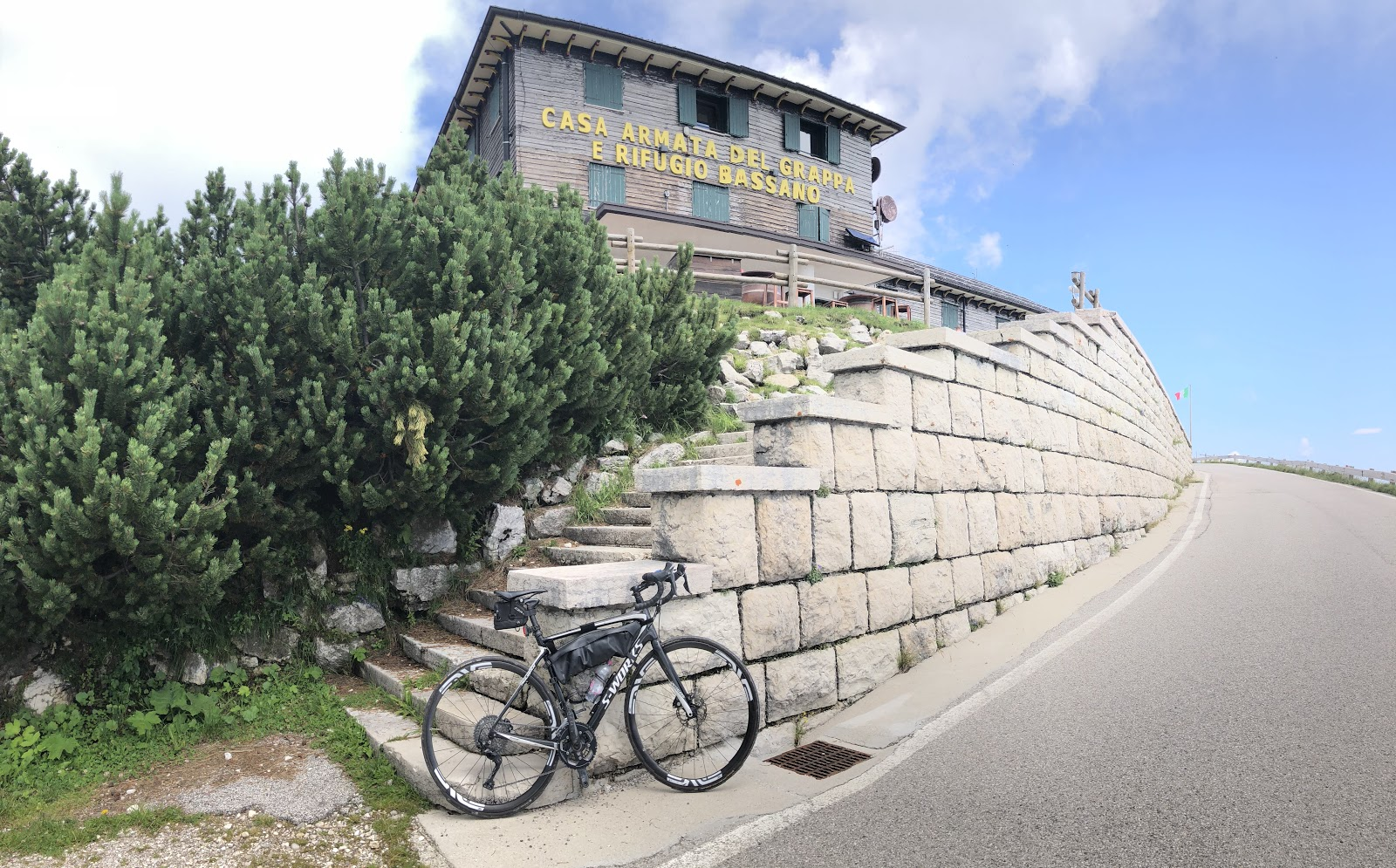 Cycling Monte Grappa from Possagno - bike leaning against steps - rifugio basano grappa
