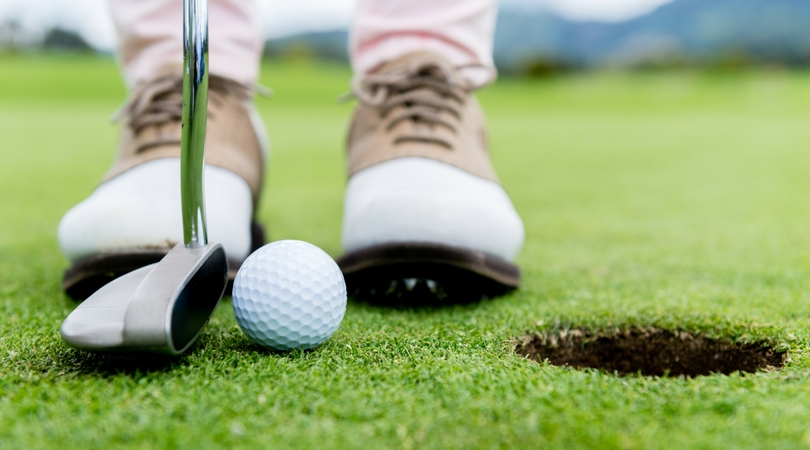 upclose golf shoes, golf ball, and putter