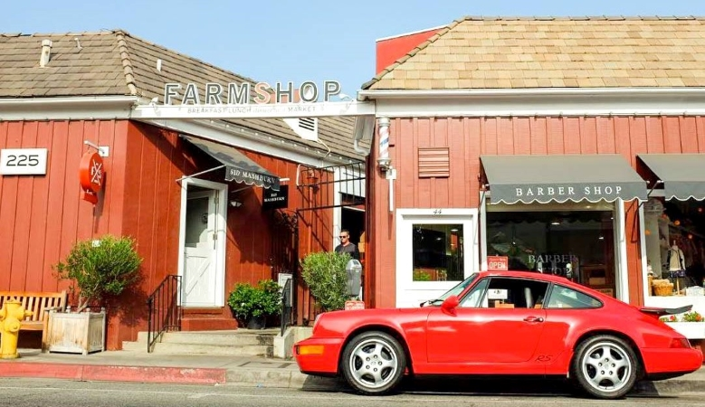 A classic sports car parked outside of Brentwood Country Mart in Los Angeles, CA