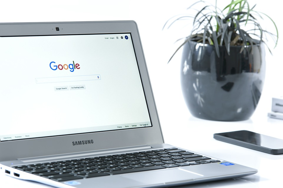 A laptop showing the Google homepage