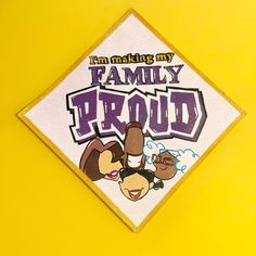 """A graduation cap that reads """"I'm making my family proud"""""""