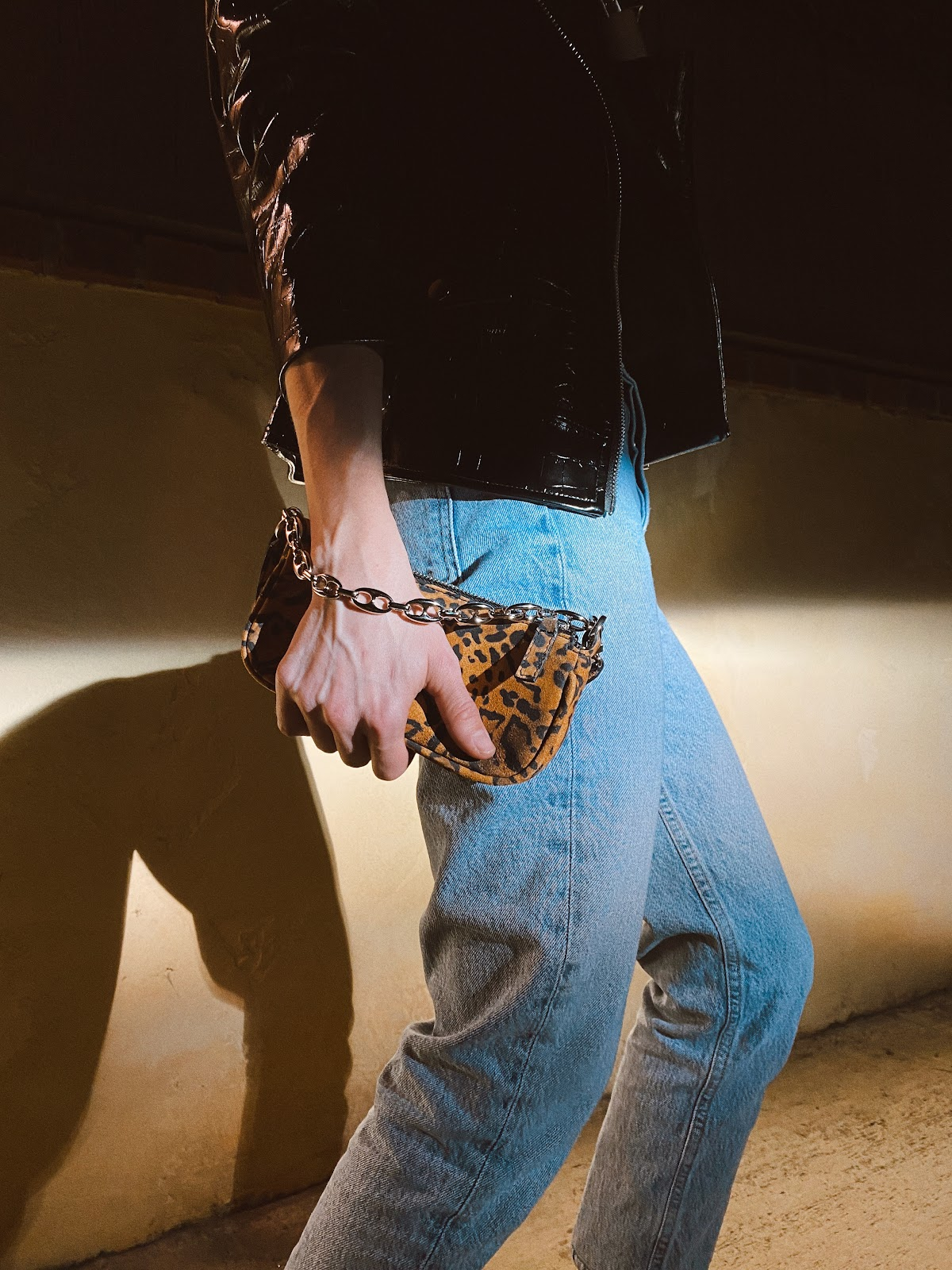 Edgy datenight look via animal print detail and a touch of metal following spring trends
