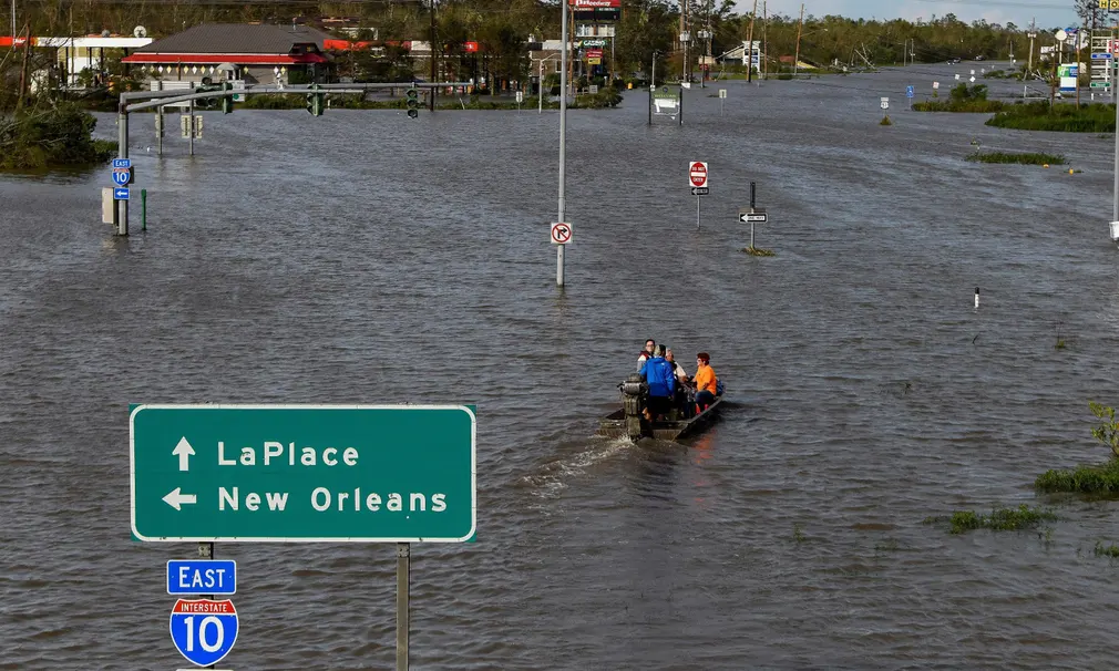 Interstate 10 under water, with a few people in the middle of all the water