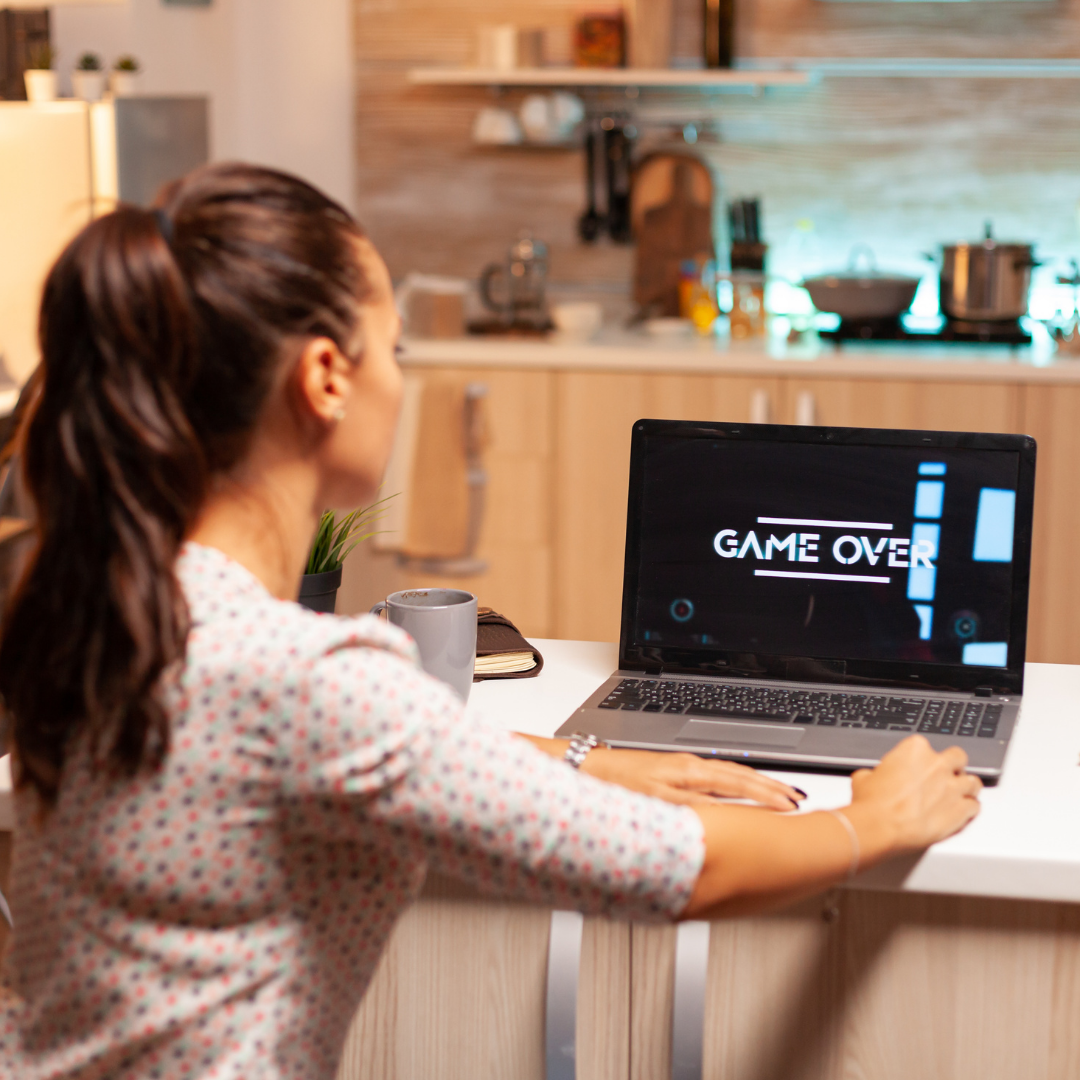 Young woman playing a game on a computer