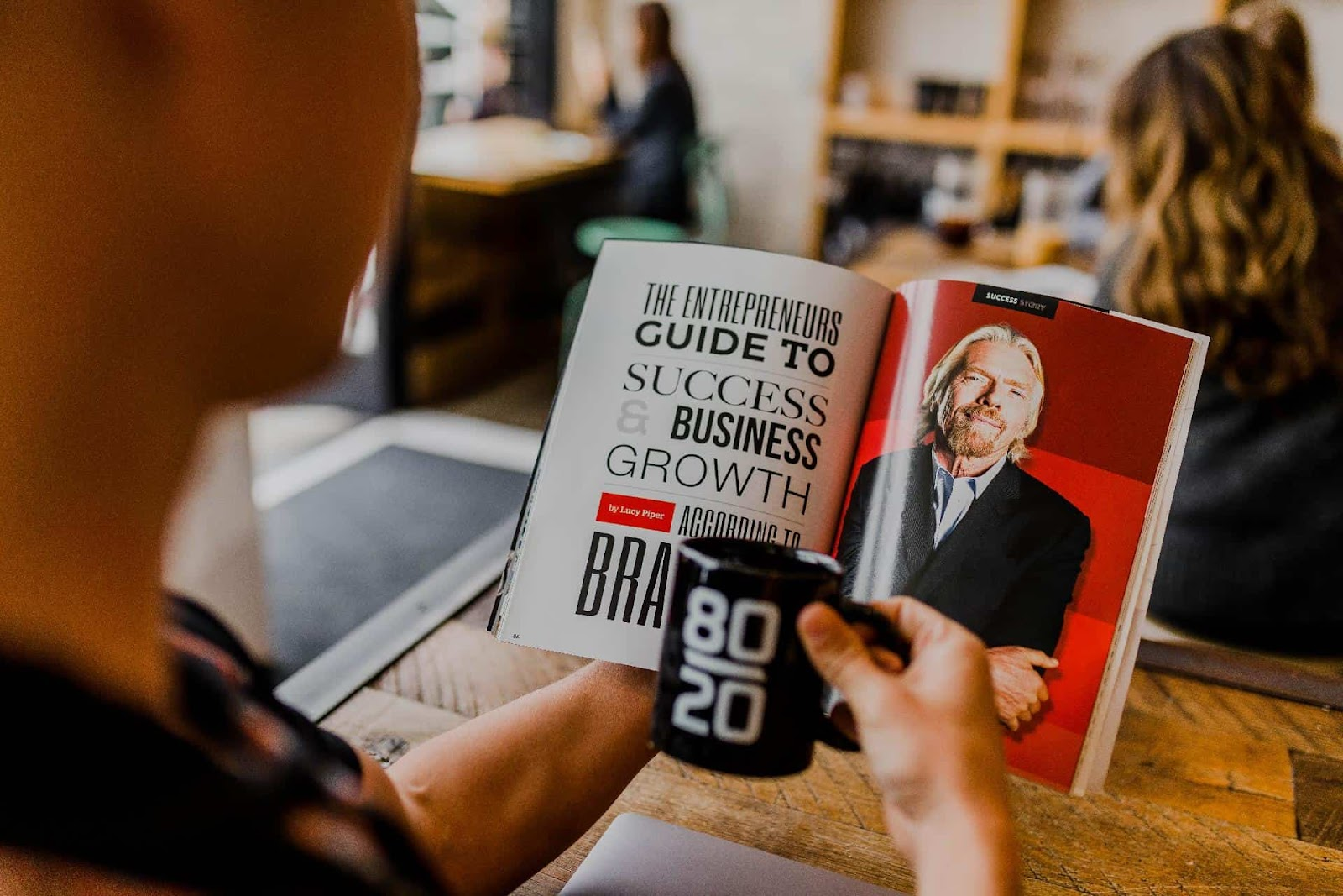 Reading a Book About Business in a Virtual Office