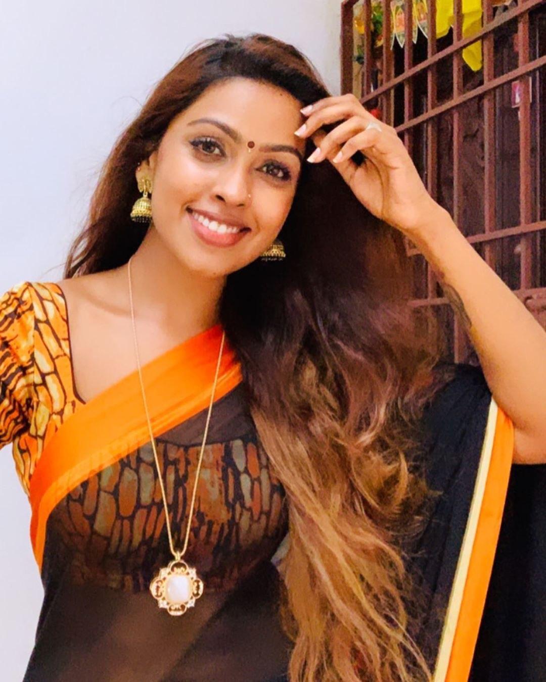 Actress Sri nikha in transparent cotton saree photos