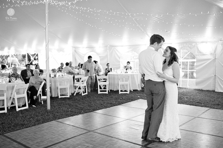 Bride and groom dancing in a wedding tent
