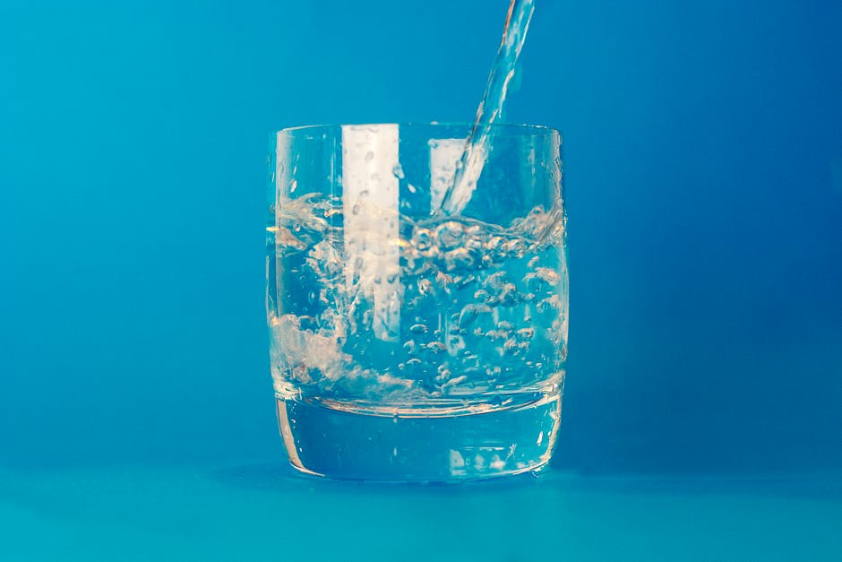 Clear Drinking Glass With Water Poured in