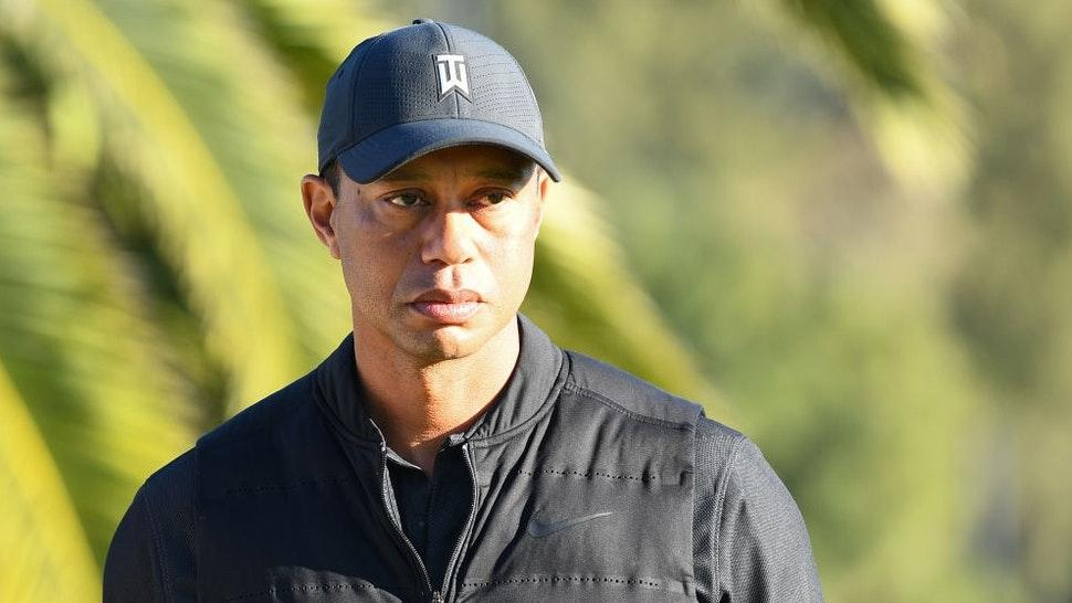 PACIFIC PALISADES, CA - FEBRUARY 21: Tiger Woods looks on from the 18th hole during the final round of The Genesis Invitational golf tournament at the Riviera Country Club in Pacific Palisades, CA on February 21, 2021. The tournament was played without fans due to the COVID-19 pandemic.(Photo by