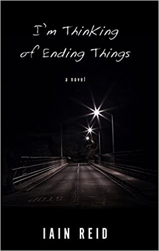 An image of an empty road over a bridge. The background is black to represent the night. Three streetlights line the bridge to the right. The title is in white text at the top center, reads I'm Thinking of Ending Things: A Novel. The author's name Iain Reid is in white text at the bottom center of the image.