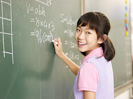 a child practicing math variables on a whiteboard