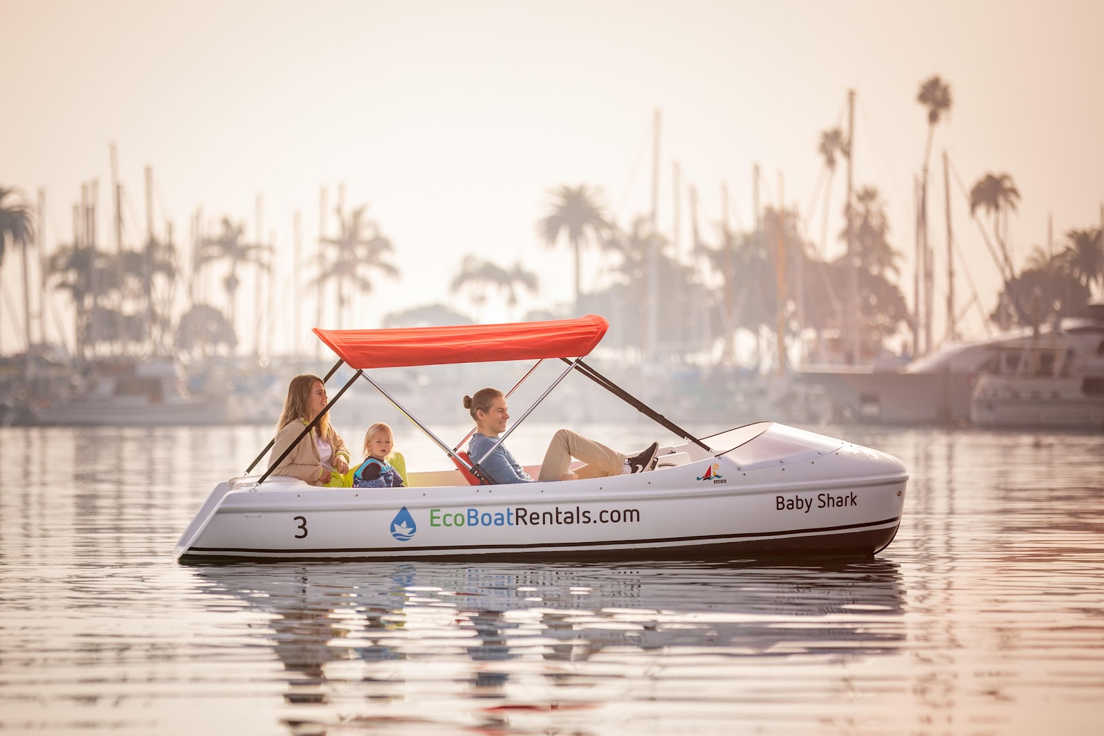 Eco pedal boat with 2 adults and a kid. Family-friendly activity