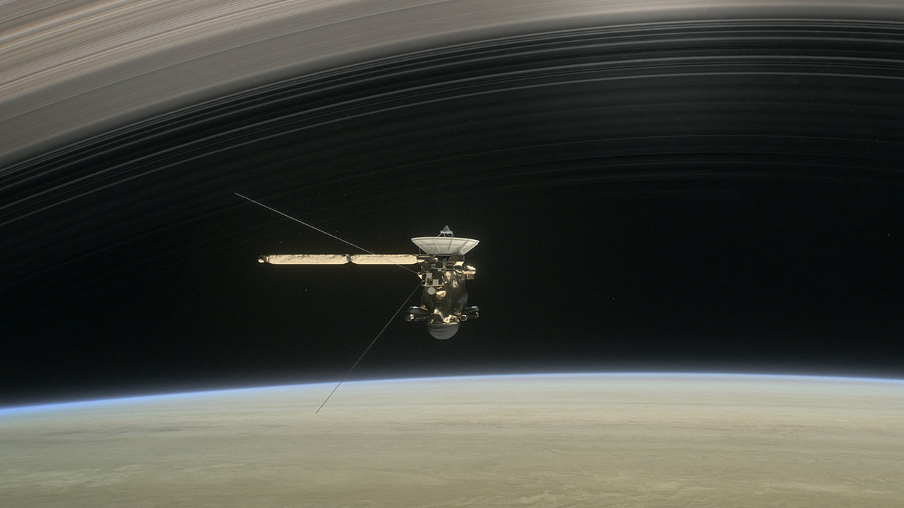 Artist's concept of Cassini diving between Saturn and its innermost ring.
