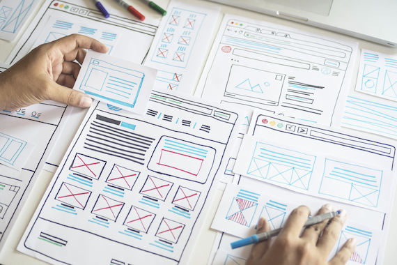 UX design process: man drawing a template layout for prototype framework
