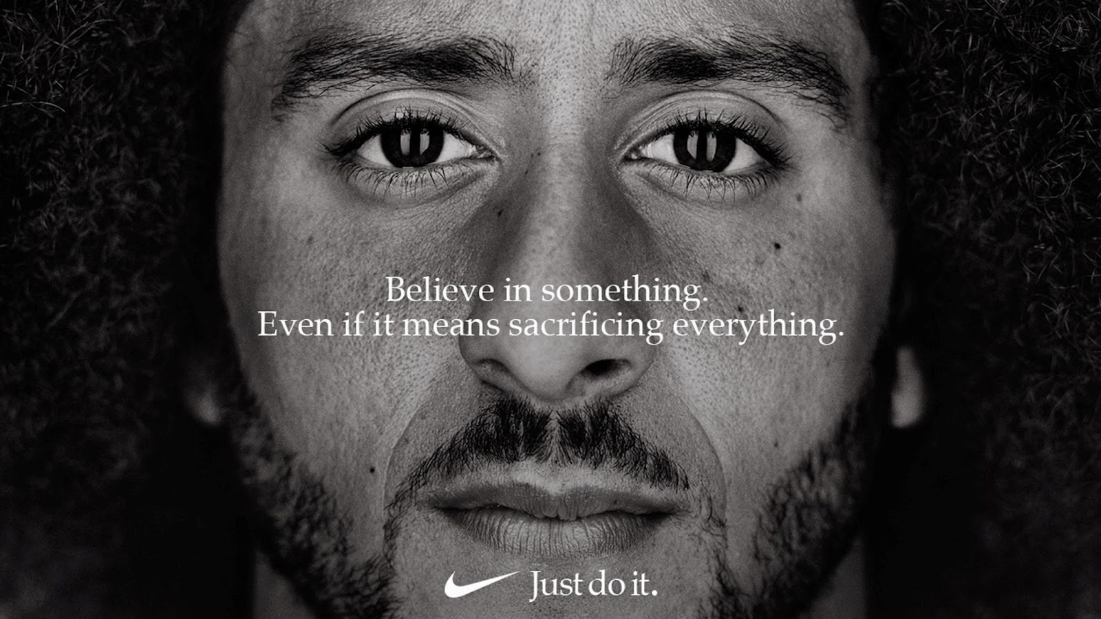 A man with beards and a straight face encouraging to believe in something even if it means sacrificing everything.