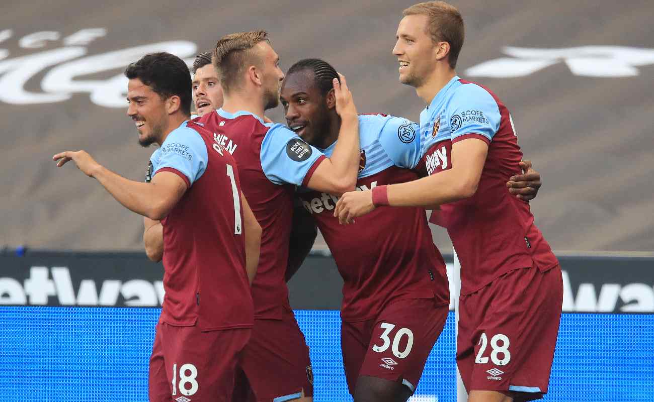 Michail Antonio of West Ham is congratulated by his teammates after scoring a goal - Photo by Adam Davy/Pool via Getty Images