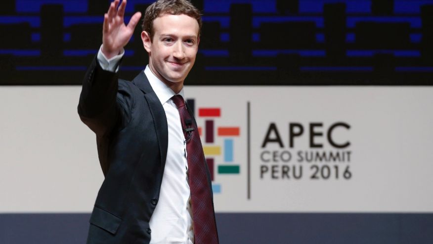 FILE - In this Saturday, Nov. 19, 2016 file photo, Mark Zuckerberg, chairman and CEO of Facebook, waves at the CEO summit during the annual Asia Pacific Economic Cooperation (APEC) forum in Lima, Peru.