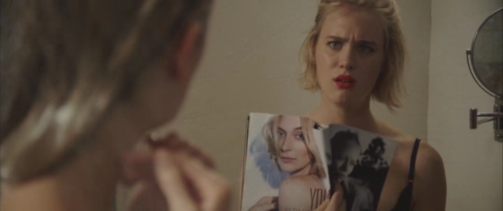 Anna (Davis) holds up a copy of the Young Hollywood edition of a magazine, in which Beth (FitzGerald) is featured.