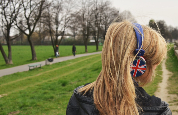 Blonde girl wearing united kingdom flag headphones