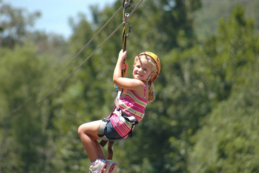 Little girl on zipline smiling