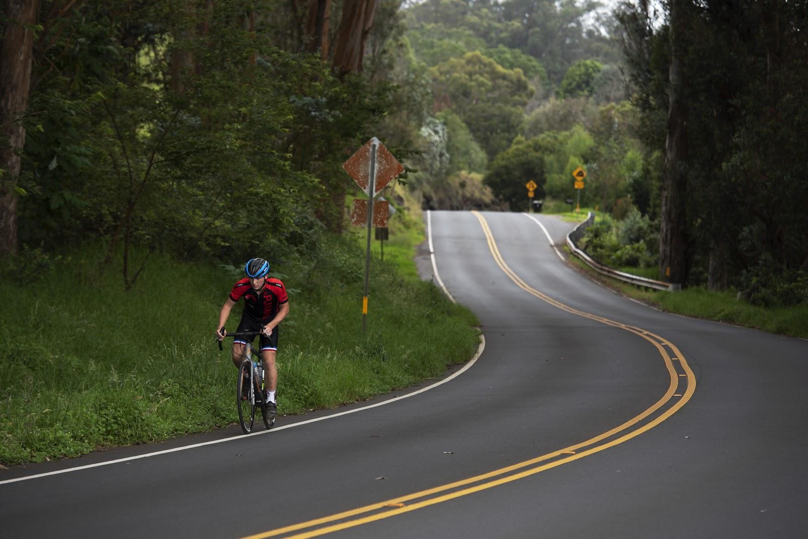 Riding by bike past the Haleakala park sign