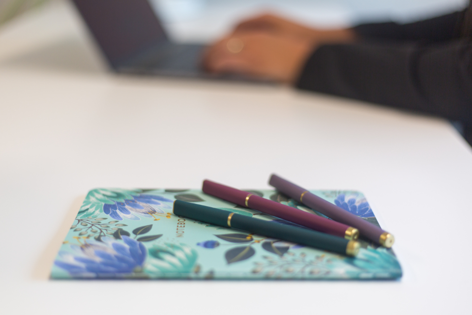 notebook and pens at online business office