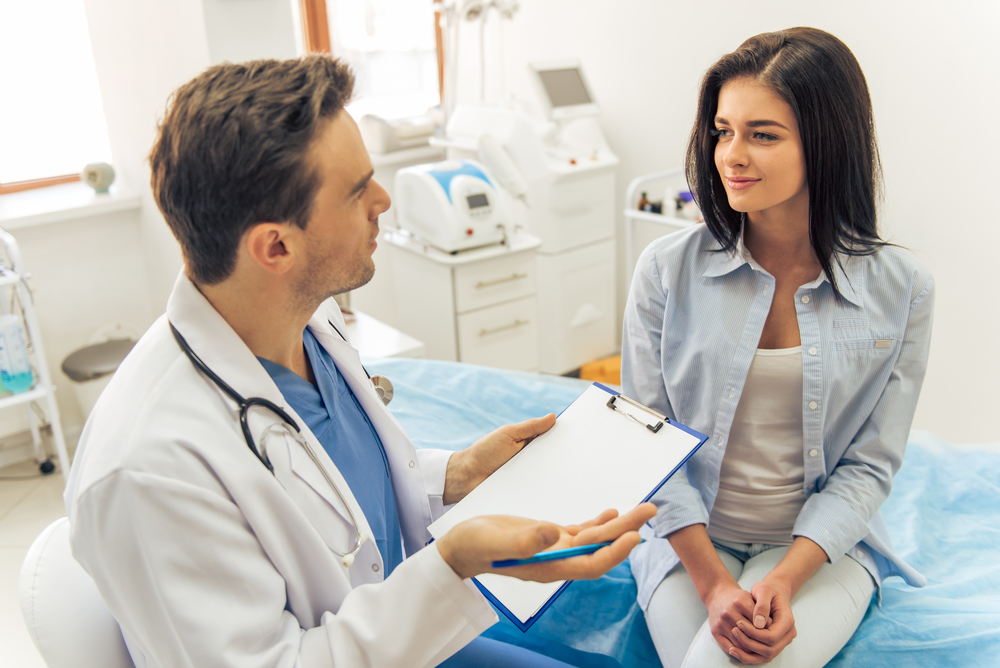 Male doctor talking to a female patient