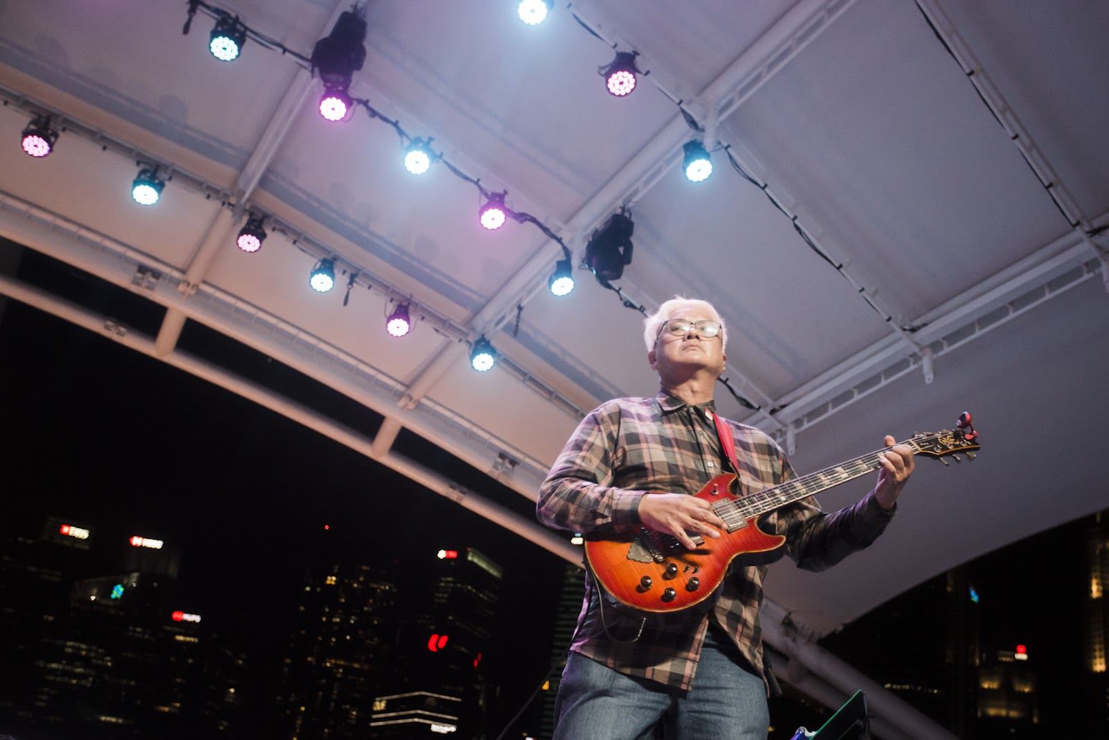 Kelvin Tan performing at Esplanade with the Oddfellows