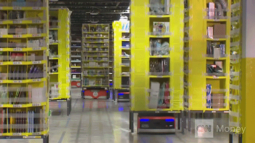 GIF of robots moving shelves in a warehouse