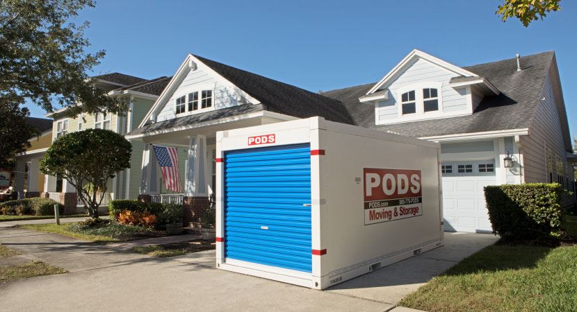 A PODS portable moving & storage container in a driveway