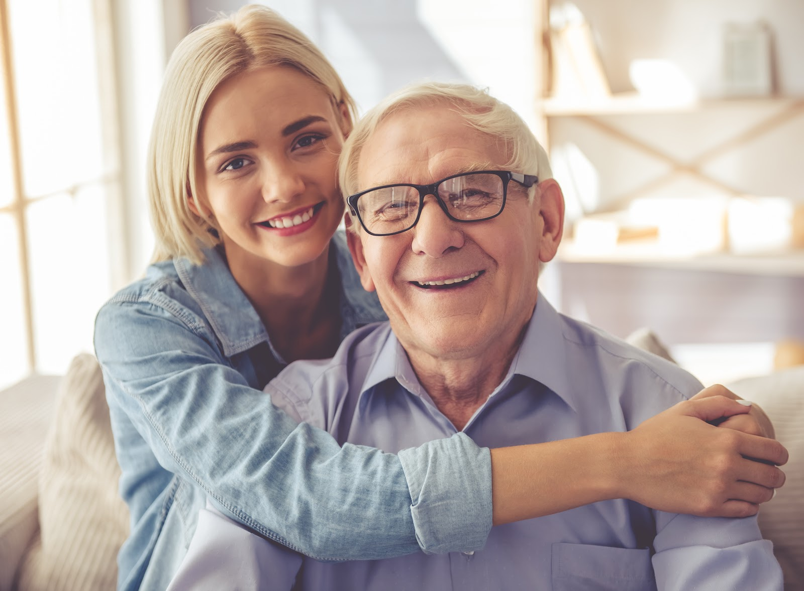 Signs of prostate cancer: Woman hugging her father and smiling