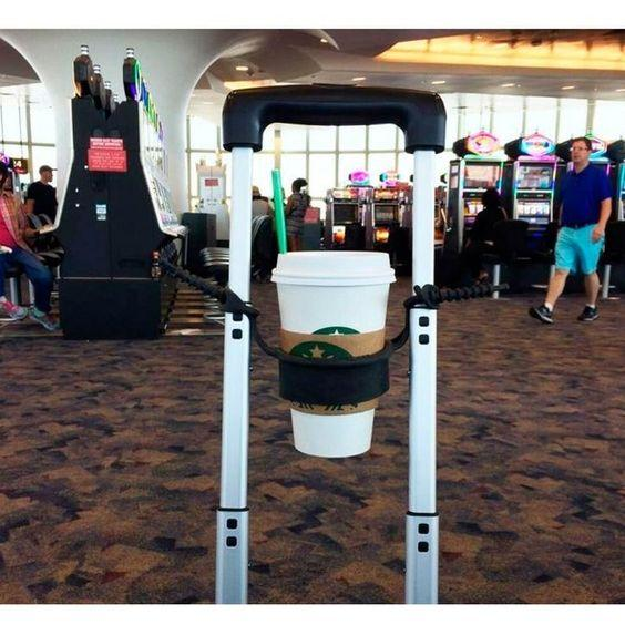 This cup holder that fits perfectly onto your rolling suitcase handle:
