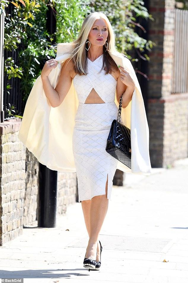Caprice catches the eye in a white cut out midi dress   Daily Mail Online
