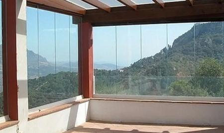 cortina de cristal con cerramientos