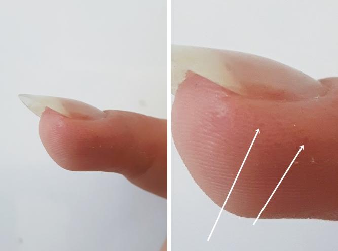 czarne kropki na paznokciach