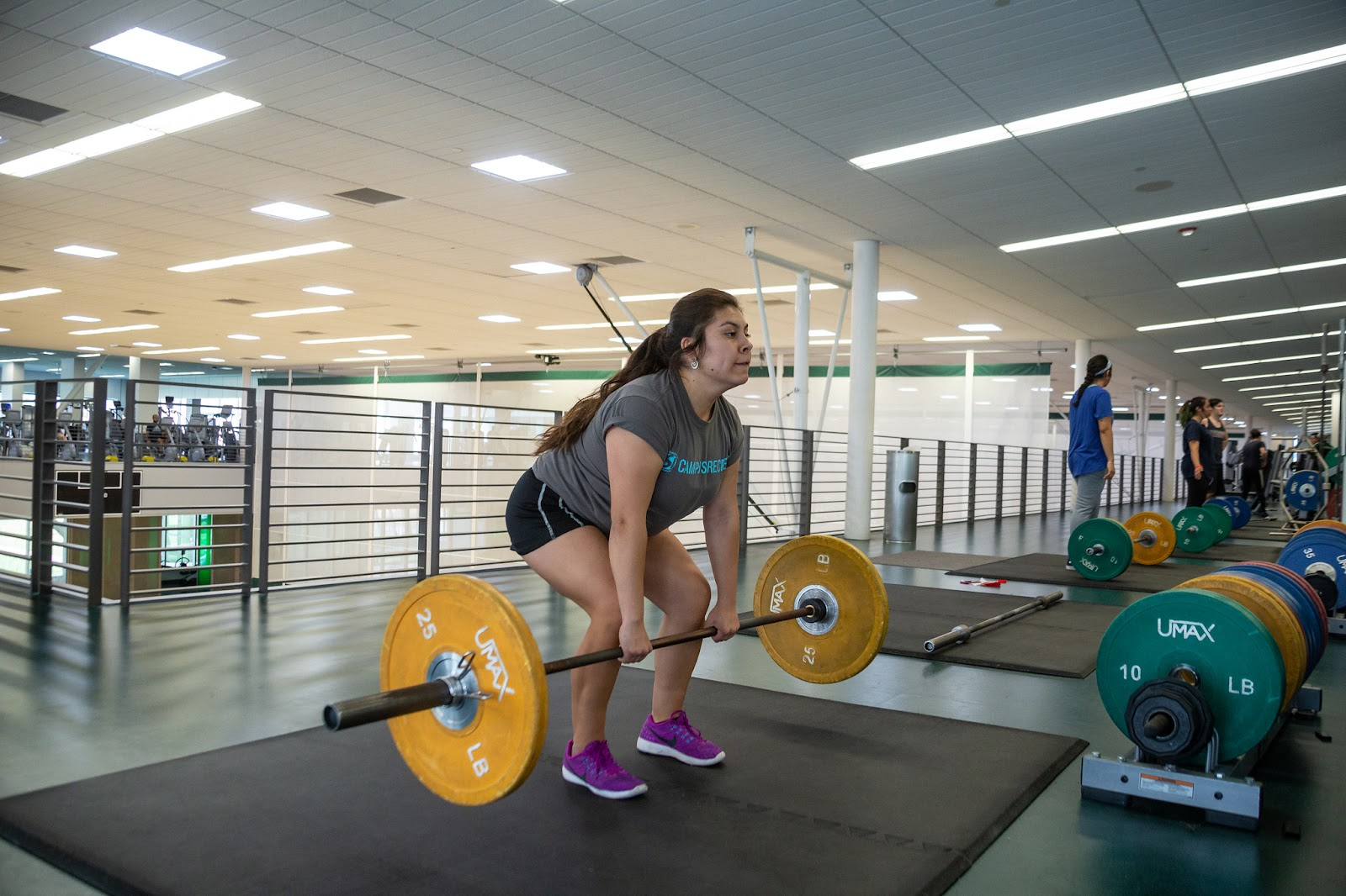 Arellano Rodriguez showing her strength and focus while deadlifting weights