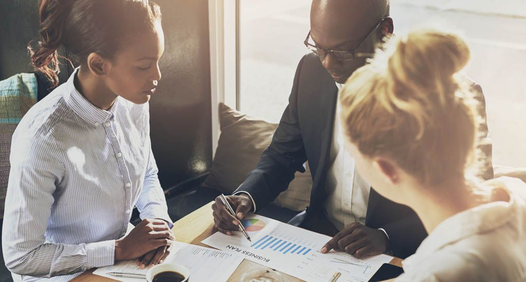 Marketing team skimming over business plan