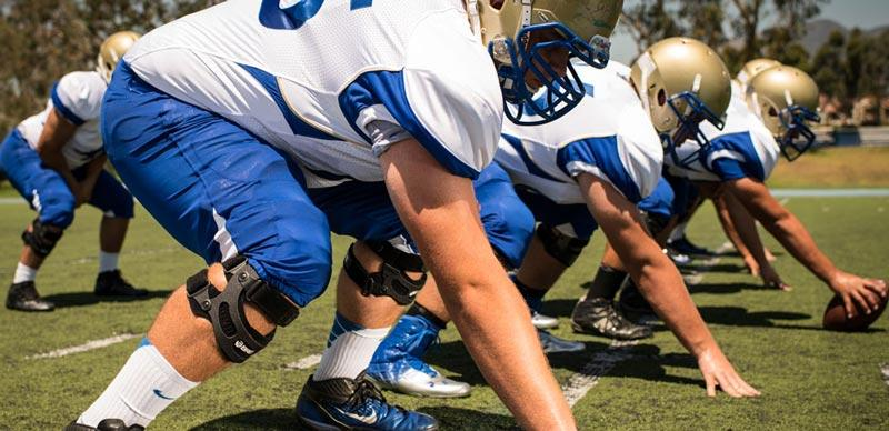 Image result for Why do Linemen and offensive linemen wear knee braces?