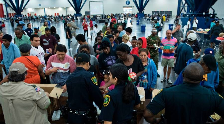 Source: Marketplace (Flood victims gathering for food in the aftermath of Hurricane Harvey)