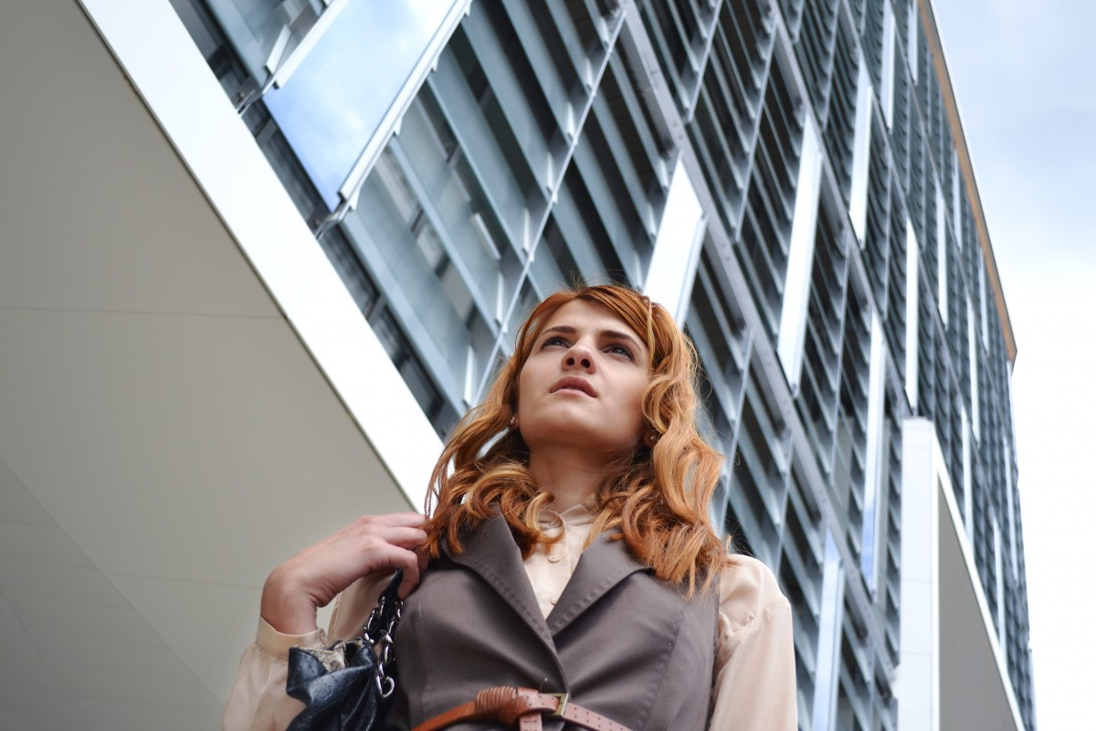 work person girl woman hair street building city urban female portrait model young corporate office professional business lady lifestyle modern outerwear long hair outdoors beauty elegant attractive success businesswoman business woman portrait outdoors business center