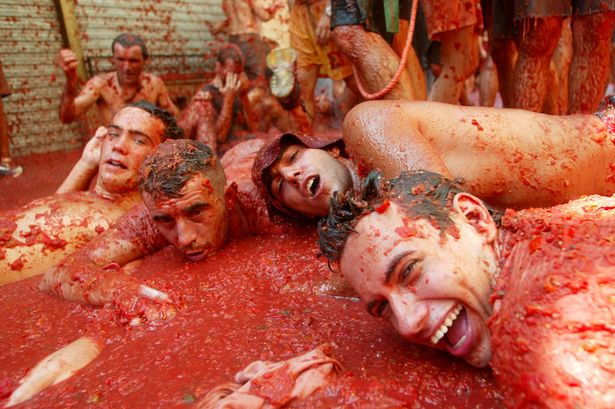 Revellers lie in tomato pulp