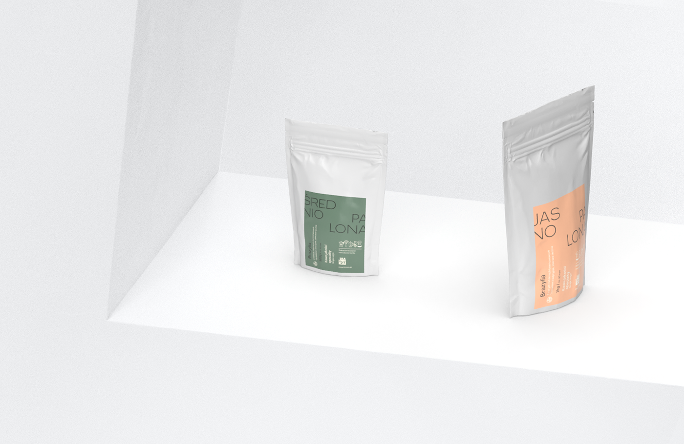 Two coffee bag standing on a white set with sharp angles.