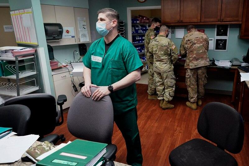 Registered nurse Army Maj. Andrew Wieher, with the Urban Augmentation Medical Task Force, stands at a nurses station inside a wing at United Memorial Medical Center, Thursday, July 16, 2020, in Houston. (David J. Phillip/AP)
