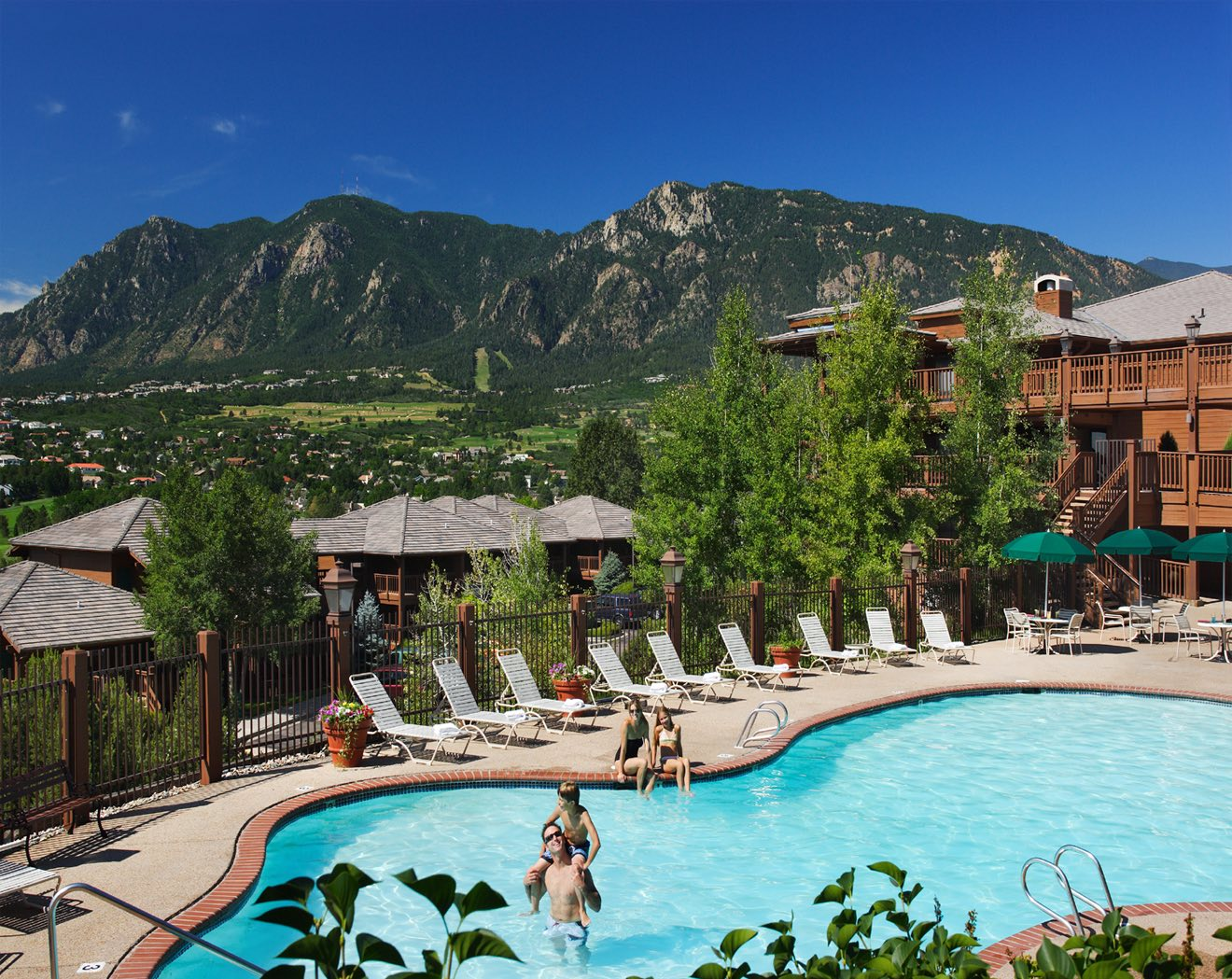pool with an awesome mountain view at Cheyenne Mountain Colorado Spring