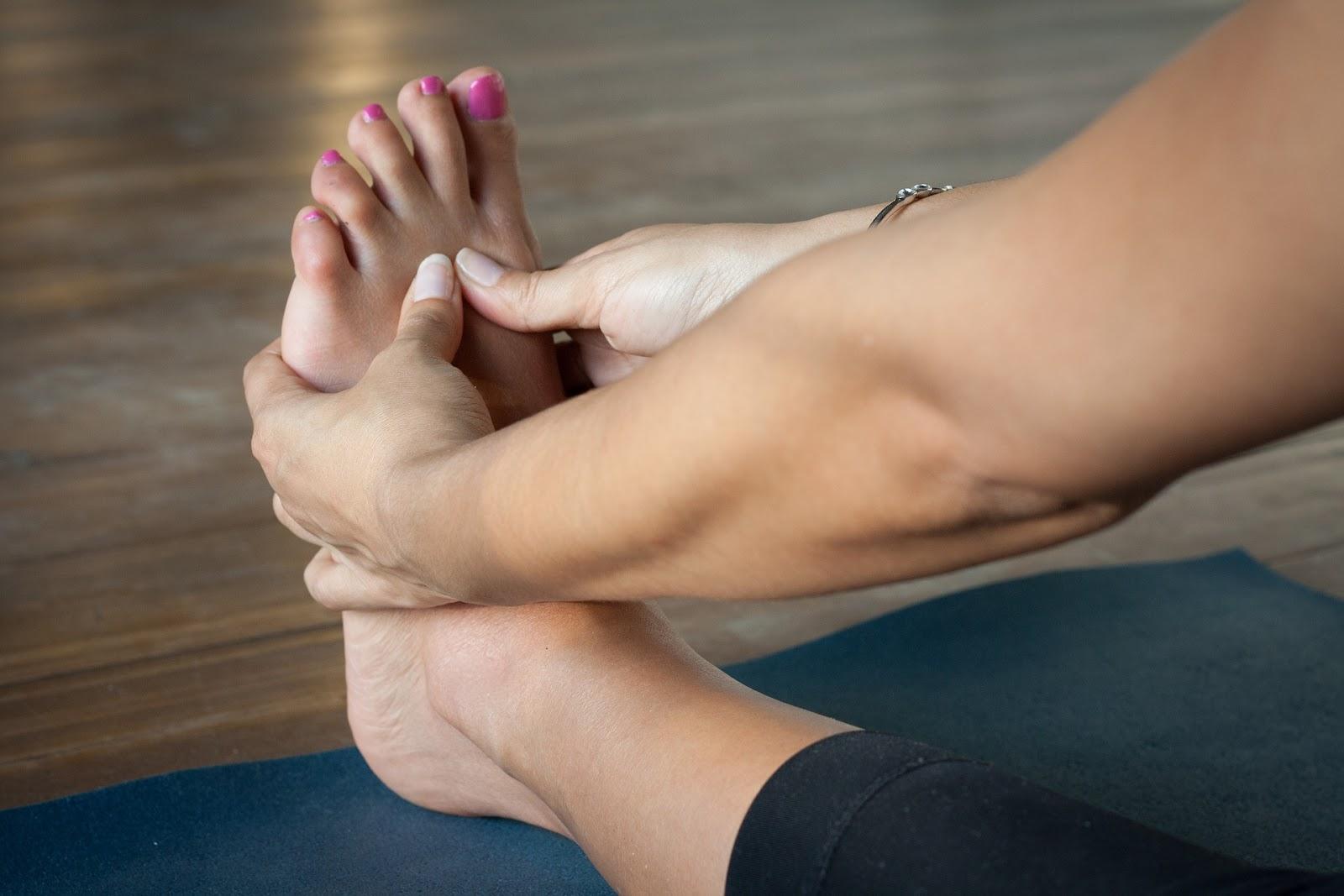 Woman massaging her own foot