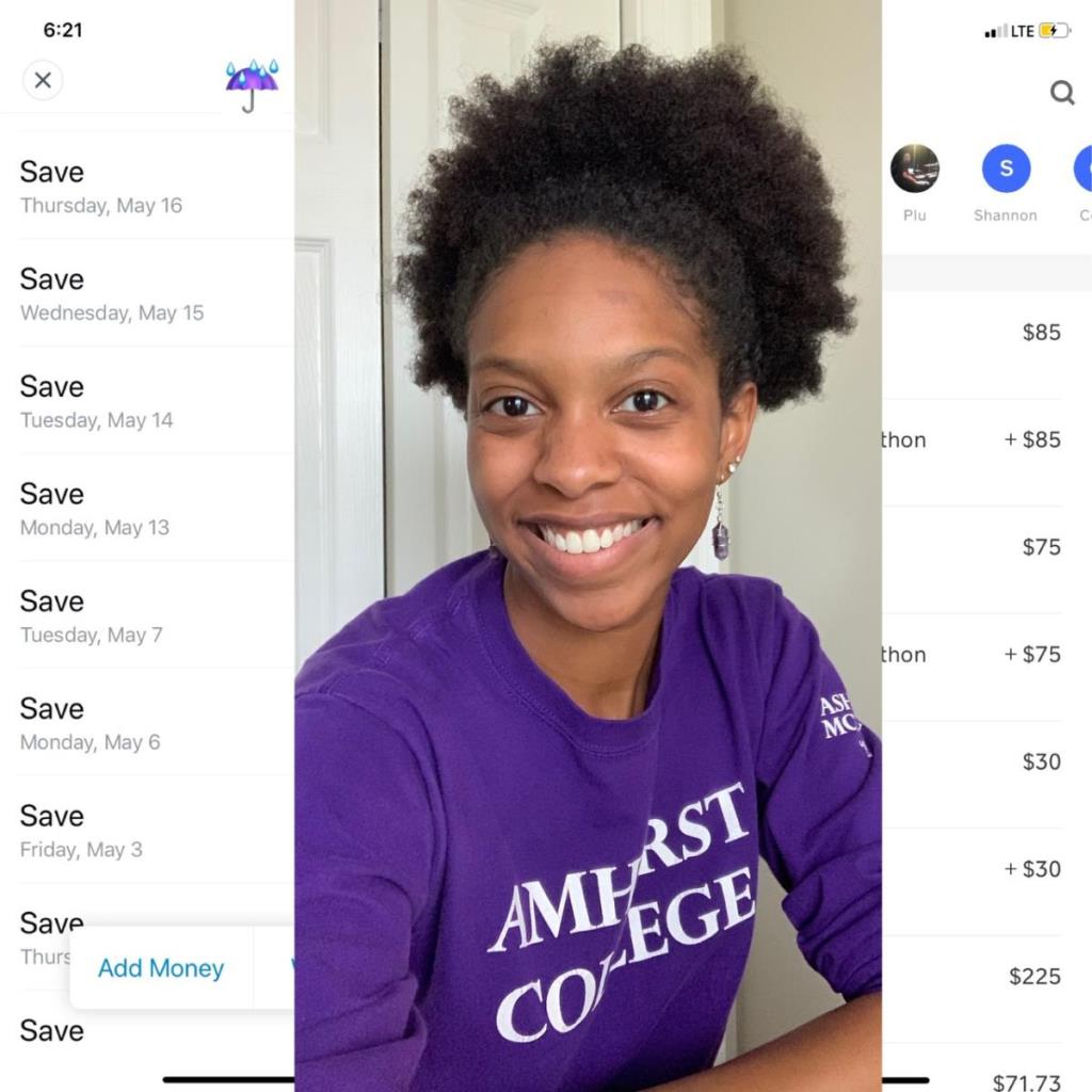 Black girl with natural hair poses for a  picture wearing a deep purple long sleeve that reads 'Amherst College' on the front as well as on her sleeve
